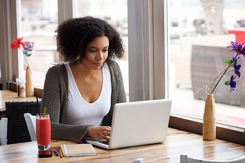 woman learning how blogs help bring in traffic to your core pages